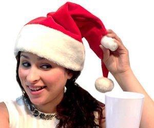 """La nostra rassegna """"Natale Kitsch"""" non smette di stupirvi con questo incredibile cappello di Natale con incorporata fischetta per poter bere in qualsiasi momento, qualsiasi cosa!"""