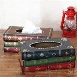 Un divertente dispenser per fazzolettini a forma di libro. Perfetto per arredare una sala o uno studio rendendo invisibile la presenza delle salviette.